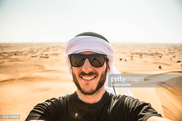 tourist man doing a selfie on the desert