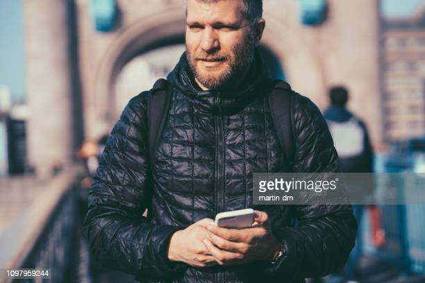 tourist man exploring london at spring - stubble stock pictures, royalty-free photos & images