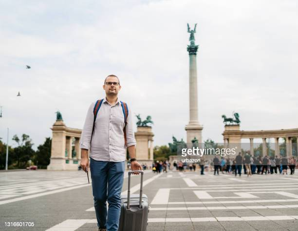 tourist man walking over heroes square - traditionally hungarian stock pictures, royalty-free photos & images
