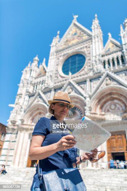 Tourist man with map in Siena - Italy