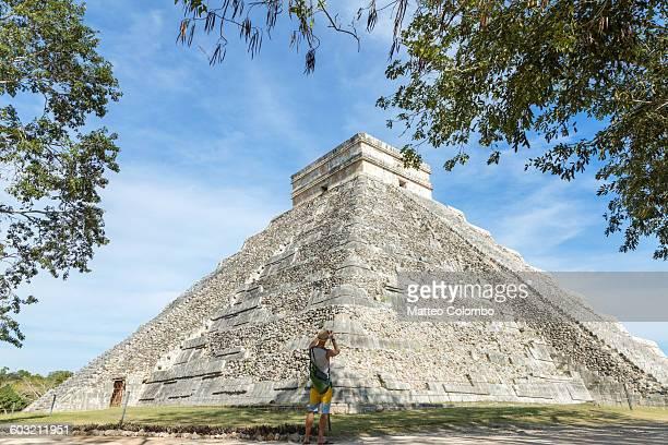 Tourist near El Castillo temple, Chichen Itza