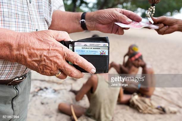 tourist, nhoma camp, bushman/ju'hoansi people, namibia - jake warga stock pictures, royalty-free photos & images