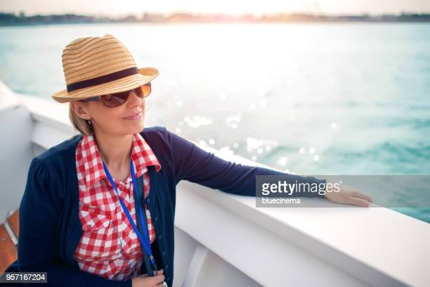 a tourist on a deck of a cruise ship - boat deck stock pictures, royalty-free photos & images