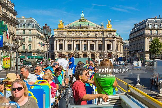 tourist on an open tour bus in paris - apple computers stock pictures, royalty-free photos & images