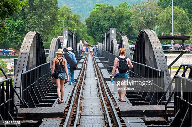tourist on famous bridge in kanchanaburi, thailand - bridge over the river kwai stock pictures, royalty-free photos & images