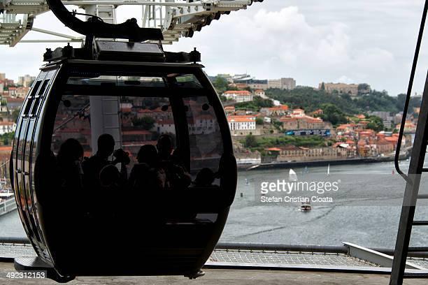 CONTENT] Tourist on lift cabin enjoying Porto view Porto view from Teleferico de Gaia