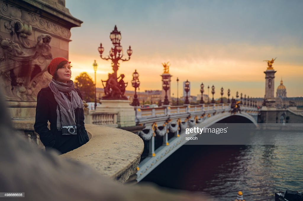 Tourist on Pont de la Concorde in Paris at dusk. : Stock Photo