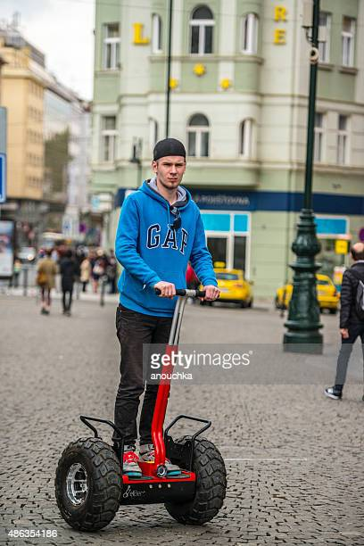 tourist on segway in prague, czech republic - segway stock pictures, royalty-free photos & images