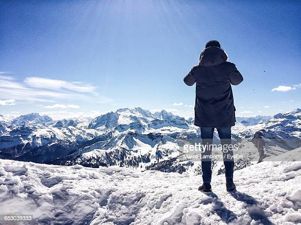 Tourist On Snow Covered Mountain