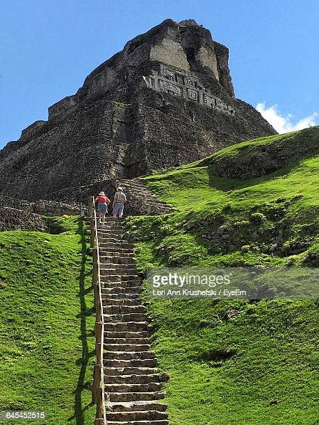 Tourist On Steps By Xunantunich Against Sky
