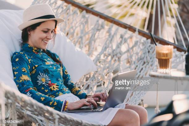 tourist on summer vacation combining work and leisure - nomadic people stock pictures, royalty-free photos & images