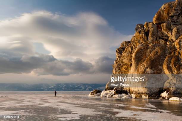 Tourist on the ice of Baikal in winter