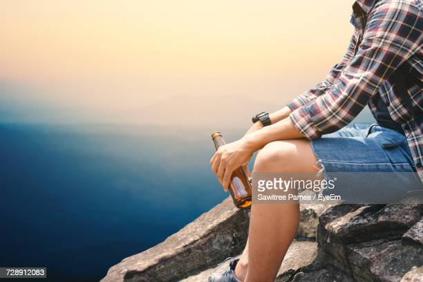 Tourist On Top Of A Cliff
