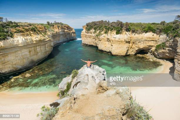 Tourist overlooking the beautiful Loch Ard Gorge, Great Ocean Road, Australia