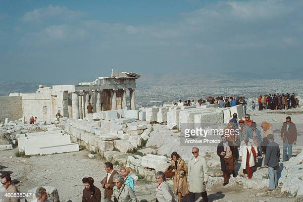 A tourist party on the Acropolis in Athens Greece with the Propylaea or gateway in the background circa 1960