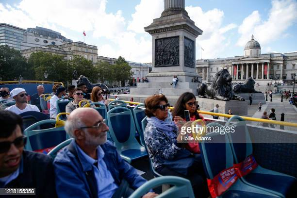 Tourist pass Trafalgar Square on a sightseeing bus on August 22, 2020 in London, England. Whilst the UK is open for business to overseas customers,...