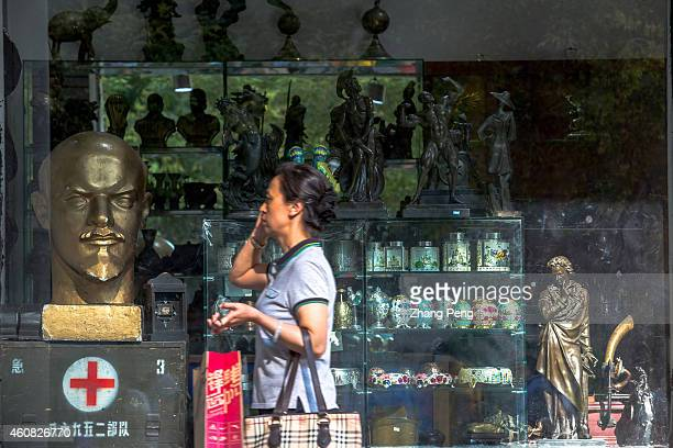 A tourist passes by a Moscow commodity shop Central Avenue is one of the main business streets in Harbin There are many Russian and other European...