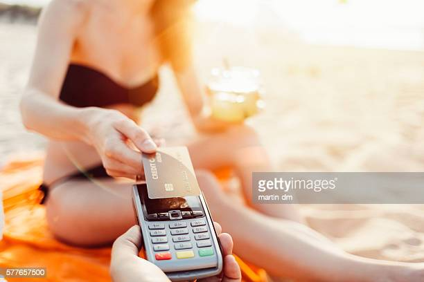 Tourist paying contactless on a vacation