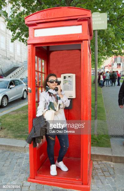 Tourist phoning from a red phone box