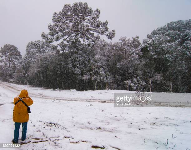 Tourist photographing a phenomenon of nature - Snow in Urubici, Santa Catarina, Brazil