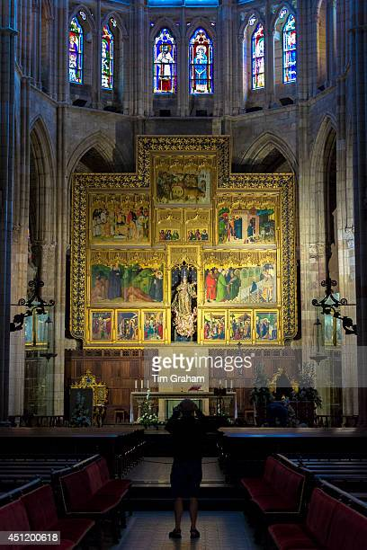 Tourist photographing altar and stained glass window in Cathedral de Santa Maria de Leon in Leon Castilla y Leon Spain