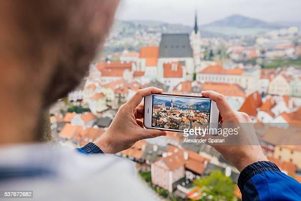 Tourist photographing Cesky Krumlov from above, South Bohemia, Czech Republic