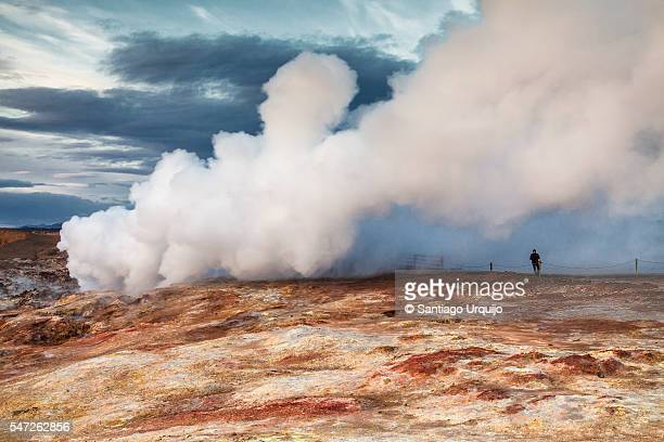 Tourist photographing hot spring area in Reykjanes peninsula