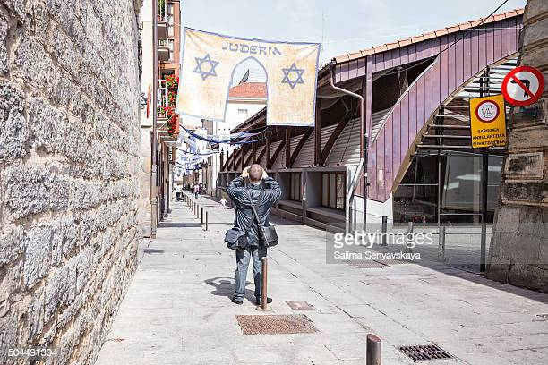 Tourist photographing Jewish quarter in Vitoria-Gasteiz