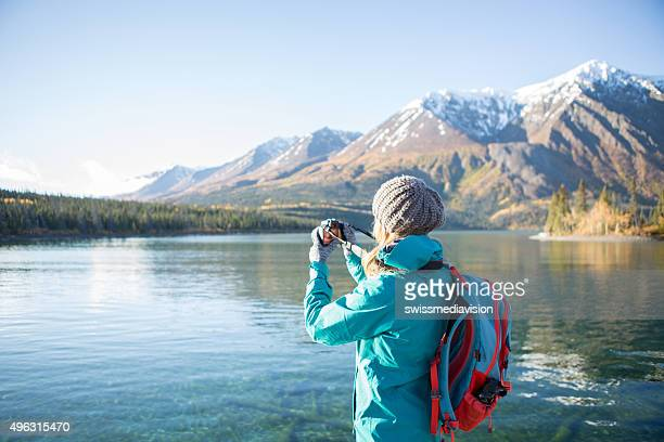 Tourist photographing landscape in Canada