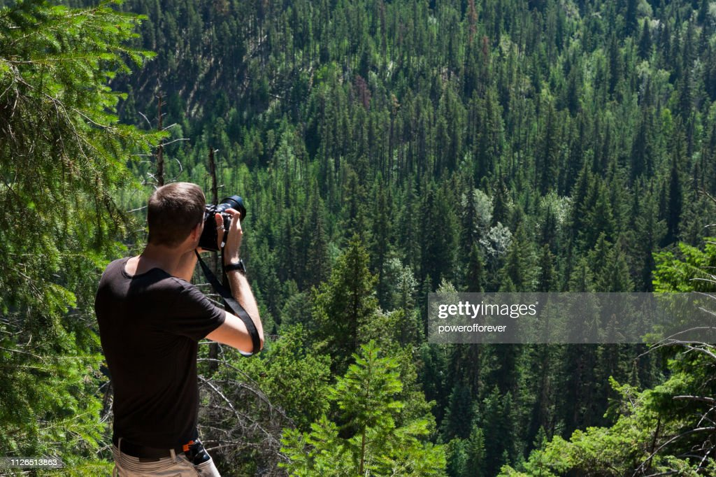 Tourist Photographing Mount Terry Fox Provincial Park in the Canadian Rocky Mountains, British Columbia, Canada : Stock Photo