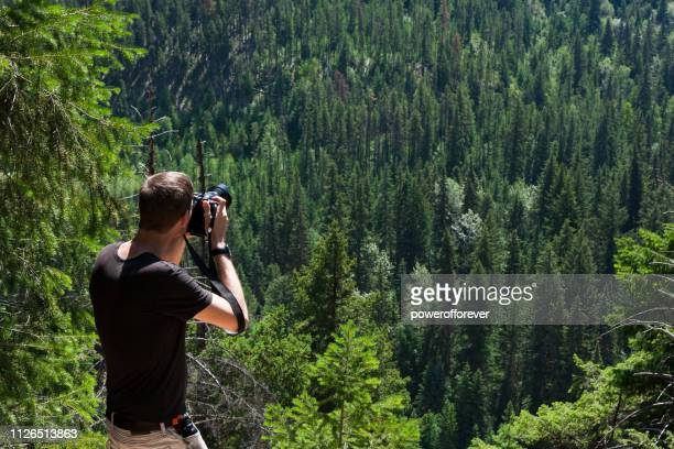 Tourist Photographing Mount Terry Fox Provincial Park in the Canadian Rocky Mountains, British Columbia, Canada