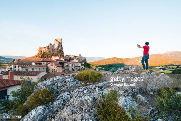 Tourist photographing the medieval town of Frias (Burgos), Spain