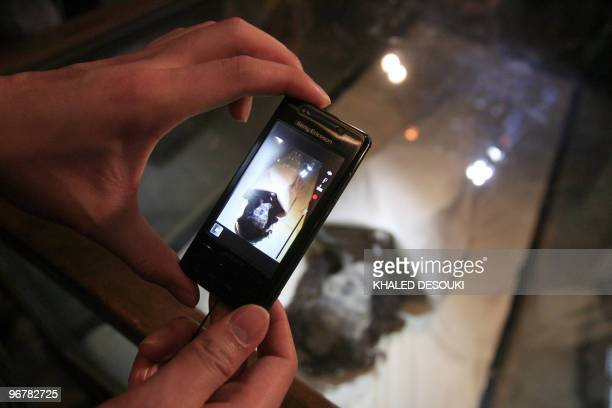 A tourist photographs the mummy of Queen Tiye Tutankhamun�s grandmother at the Egyptian museum in Cairo on February 17 2010 New research has revealed...