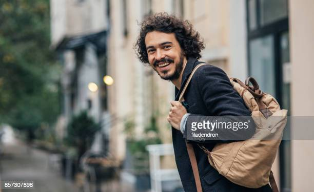 tourist - looking over shoulder stock pictures, royalty-free photos & images