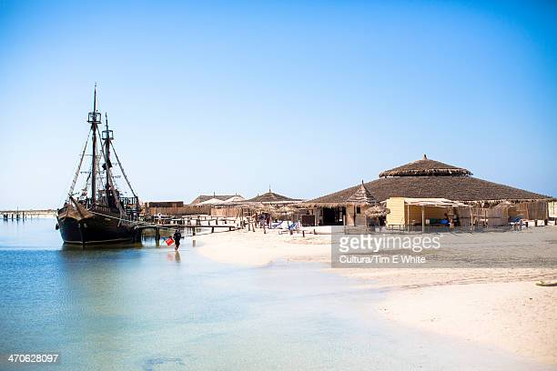 tourist pirate ship on beach, djerba, tunisia - djerba stock pictures, royalty-free photos & images