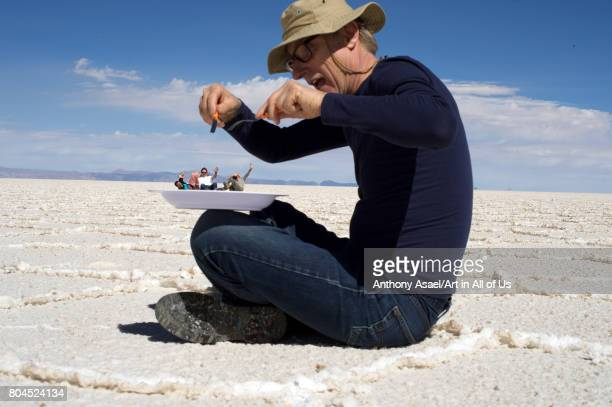 Tourist playing with photography depth effects on November 2016 in Salar de Uyuni Bolivia