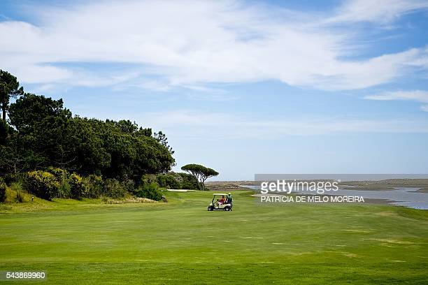 A tourist plays golf at Vilamoura Loule southern Portugal on June 10 2016 The Algarve sunny southern region of Portugal attracts more and more...
