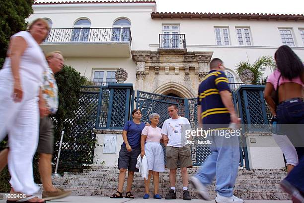 Tourist pose for pictures on the front steps of Casa Casuarina Gianni Versace''s former residence August 15 2001 in Miami Beach Florida South...
