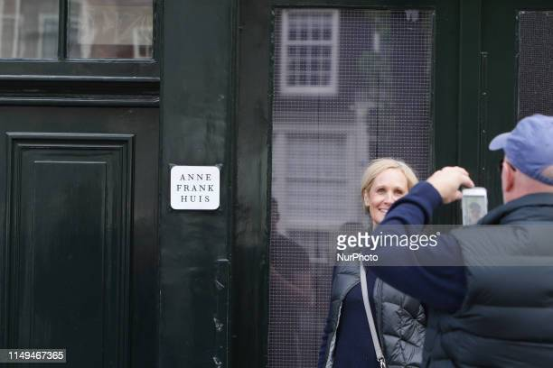 A tourist pose for the pictures in front of the Anne Frank hous remembering Anne Frank's 90th Birthday on June 12 2019 in AmsterdamNetherlands Today...