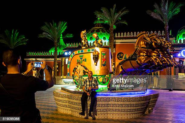 A tourist poses for a photograph at a tourist amusement park on April 3 2016 in Sharm El Sheikh Egypt Prior to the Arab Spring in 2011 some 15million...