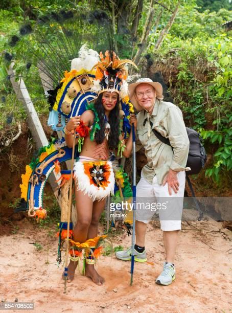 Tourist Poses for Photograph with Resident of Boca da Valeria, Brazil