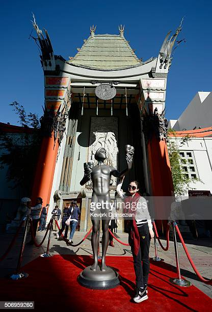 A tourist poses with the SAG Awards Actor during a visit to Hollywood's TCL Chinese Theatre in preparation for the 22nd Annual Screen Actors Guild...