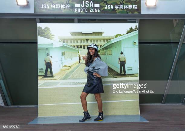 Tourist posing in front of a giant picture of the DMZ border North Hwanghae Province Panmunjom South Korea on September 8 2017 in Panmunjom South...