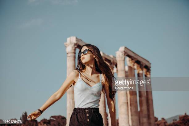 tourist posing in front of temple of olympian zeus in athens, greece - オリンピック選手 ストックフォトと画像