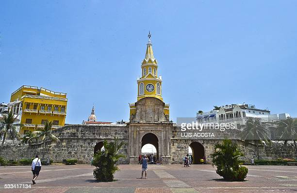 A tourist psses in front of the Watch Tower in Cartagena Colombia on May 22 2016 The urn with the ashes of Garcia Marquez arrived in Cartagena to be...