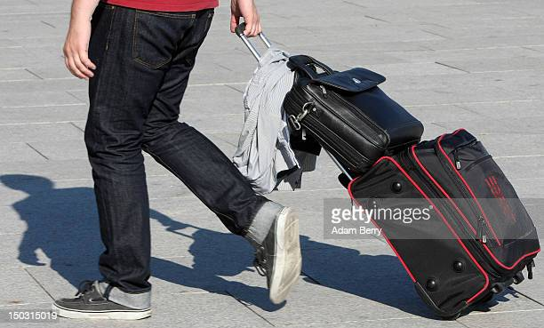 A tourist pulls a rolling suitcase on August 15 2012 in Berlin Germany In 2010 nine million tourists visited the German capital and ten million came...