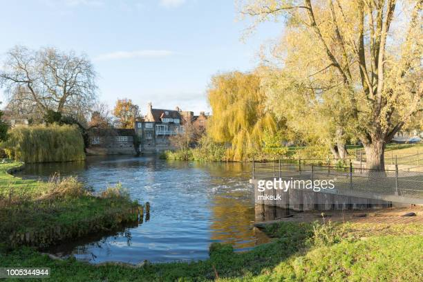 tourist punt boats and river Cam scene from the city centre of the University town of Cambridge in England