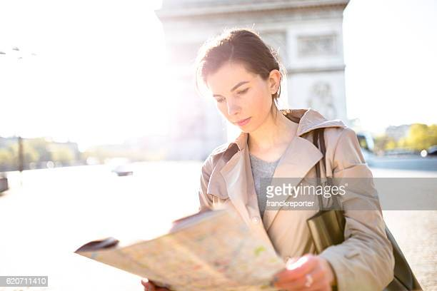 tourist read a map on paris