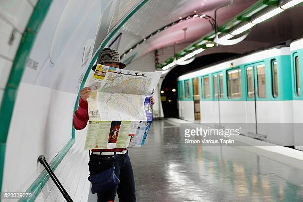Tourist Reading Map in Subway Station
