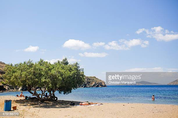Tourist relax on the beach during midday next to the town of Faro on June 19 2015 in Sifnos Greece Sifnos is a island in the western Aegean Sea the...